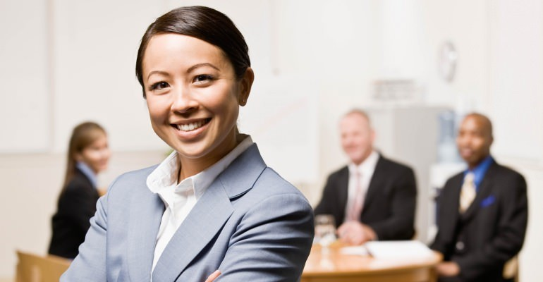 banner-confident-businesswoman-with-coworkers-in-background